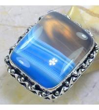 Серебряное кольцо с голубым ониксом 17р