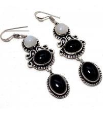 Серебряные серьги-подвески с лунным камнем и черным ониксом