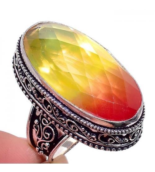 купить кольцо с двухцветным камнем